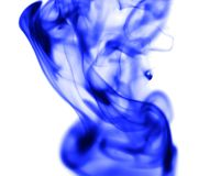 Blue smoke on white background. Photo of an abstract texture Stock Image