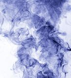 Blue smoke on a white background. inversion.  Stock Images