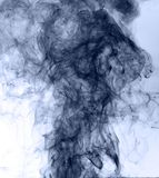 Blue smoke on a white background. inversion.  Stock Photos