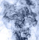 Blue smoke on a white background. inversion.  Royalty Free Stock Photography