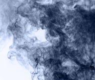Blue smoke on a white background. inversion.  Stock Image