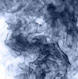 Blue smoke on a white background. inversion.  Stock Photo