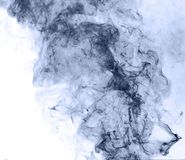 Blue smoke on a white background. inversion.  Royalty Free Stock Photo