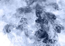 Blue smoke on a white background. inversion.  Royalty Free Stock Images