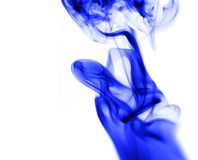 Blue smoke on white background. Photo of an abstract texture Royalty Free Stock Images