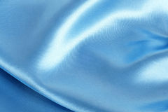 Blue smooth satin textile Stock Photography