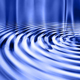 Blue Smooth Water Ripples. Sparkling water ripple swirls shine as light reflects beautiful and refreshing colors of blue Royalty Free Stock Images