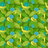 Blue snails on green leaves Royalty Free Stock Photography