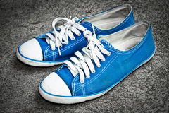 Blue sneaker royalty free stock photography