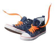 Blue sneaker with orange laces isolated