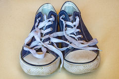 Blue sneaker with white laces Stock Photos