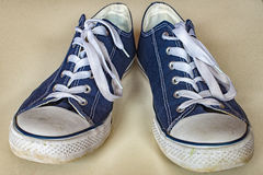 Blue sneaker with white laces Royalty Free Stock Photos