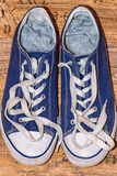 Blue sneaker with white laces Royalty Free Stock Photo