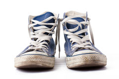 Blue sneakers. The blue sneakers on white background Royalty Free Stock Photo