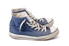 Blue sneakers. The blue sneakers on white background Royalty Free Stock Images