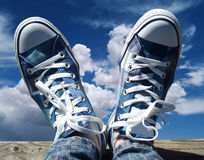 Blue sneakers. Closeup of blue sneakers on a sky background Stock Photos