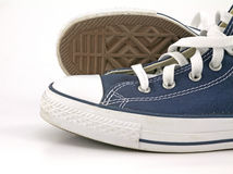 Blue sneakers. Over the white background Royalty Free Stock Photos