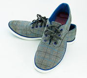 Blue sneakers Stock Photos