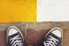Blue sneakers. Blue sneakers from an aerial view on concrete block pavement. Top view, feeling between choose, choice royalty free stock image