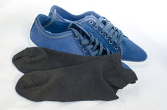 Blue sneakers and ankle socks Royalty Free Stock Image