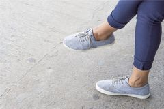 Blue sneakers on asian female feet. With copy space for text. fashion concept. waiting concept Stock Photos