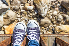Blue sneakers on the beach Royalty Free Stock Photos