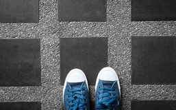 Blue sneakers on black and white Stock Photos