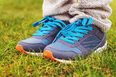 Blue sneakers on child's feet. Close up of blue sneakers on child's feet Royalty Free Stock Photography