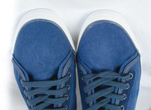Blue sneakers detail royalty free stock photography