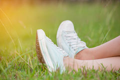 Blue sneakers. In the grass Royalty Free Stock Photography
