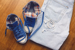 Blue sneakers and headphones Royalty Free Stock Photography