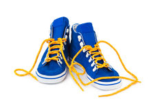 Blue sneakers. Isolated on white background Royalty Free Stock Image