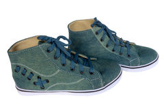 Blue sneakers. One pair of jeans, an old form Royalty Free Stock Photo