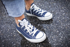 Blue Sneakers in the Rain Royalty Free Stock Photography