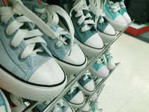 Blue sneakers on the shelves Royalty Free Stock Photo