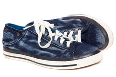 Blue sneakers on white background Stock Images