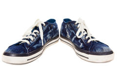Blue sneakers on white background Royalty Free Stock Photos
