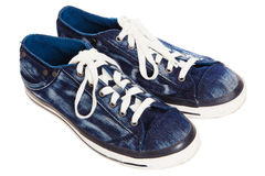Blue sneakers on white background Stock Photos