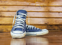 Blue sneakers on the wooden floor Stock Image