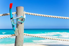 Blue snorkeling mask hangs on the wooden pier Royalty Free Stock Images