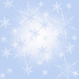 Blue snow background. With many snowflake Stock Photography
