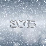 Blue Snow 2015. Blue background with falling snow and numbers of 2015. New year symbol stock illustration
