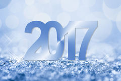 2017 blue snow and bokeh greeting card Royalty Free Stock Image