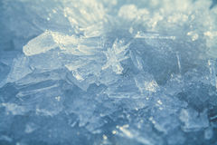 Blue snow ice crystals. Melting blue snow ice crystals in the spring stock photography