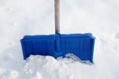 Blue snow shovel Stock Photography