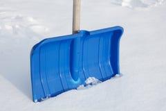 Blue snow shovel Stock Photos