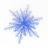 Blue Snowflake. Isolated blue 3d ice crystal snowflake Royalty Free Stock Photos