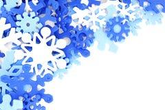 Blue snowflake border. Winter corner border of blue and white snowflake confetti Royalty Free Stock Photo