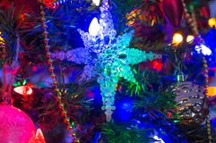 The blue snowflake garland. On the Christmas tree Royalty Free Stock Image