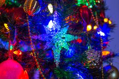 The blue snowflake garland. On the Christmas tree Royalty Free Stock Images